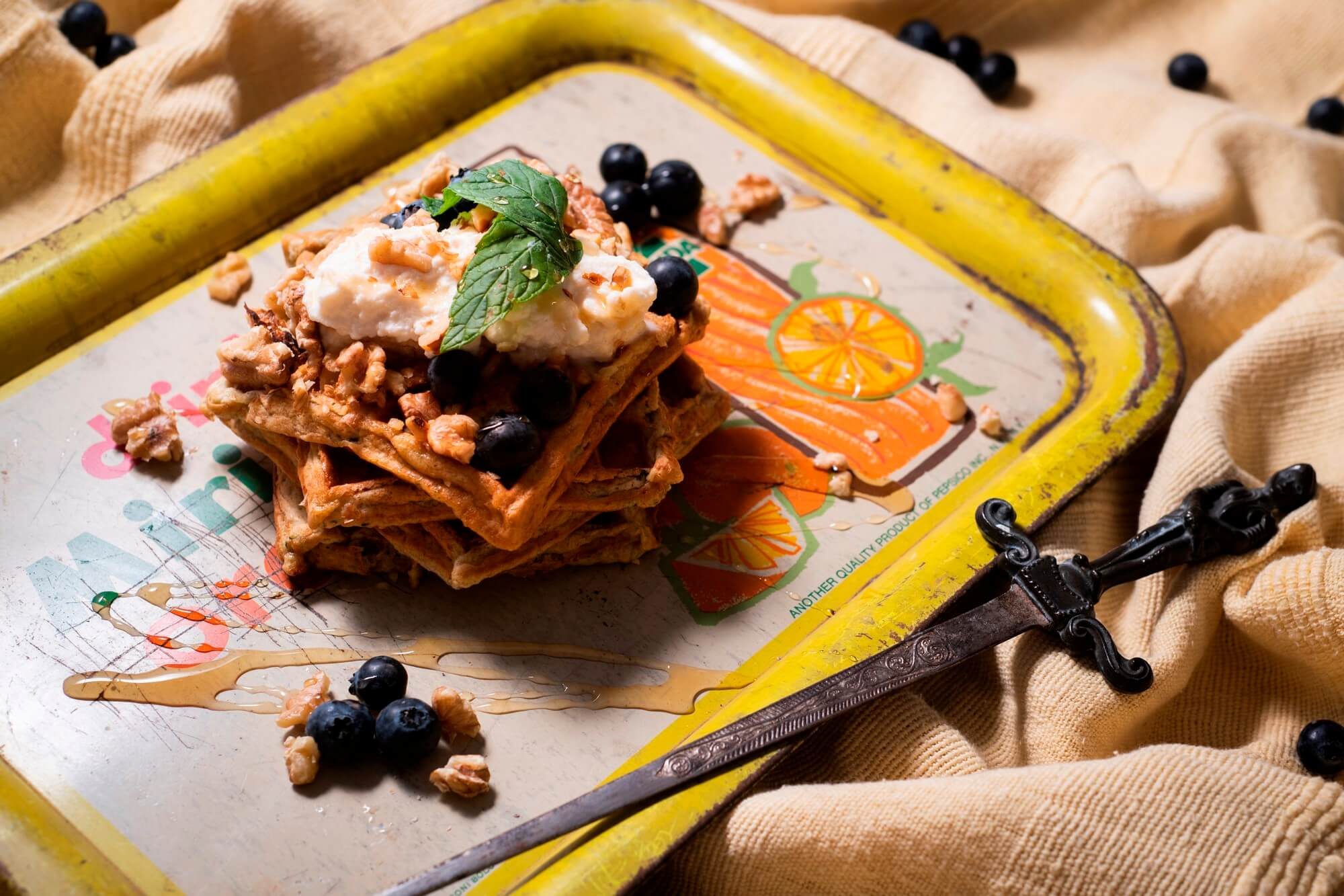 Zucchini waffles with whipped ricotta, berries and honey