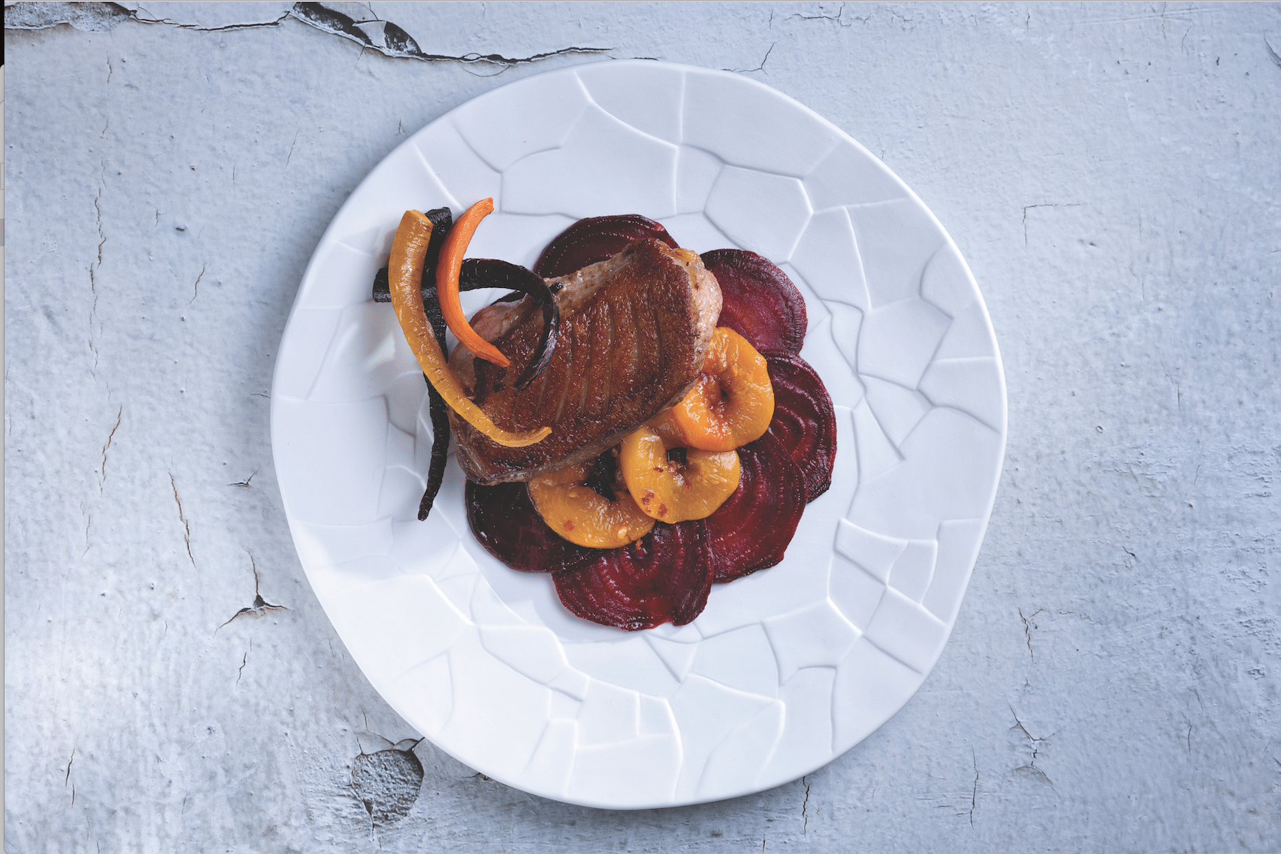 Carob Glazed Duck Breast with Baked Roots and Peaches